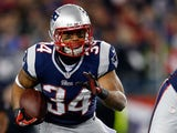Shane Vereen #34 of the New England Patriots runs the ball against the Baltimore Ravens during the 2013 AFC Championship game at Gillette Stadium on January 20, 2013