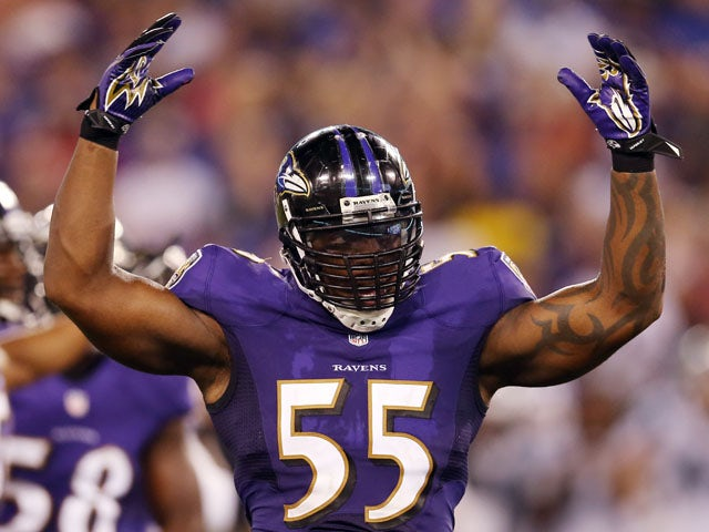Outside linebacker Terrell Suggs #55 of the Baltimore Ravens gestures to the crowd during the second half of a preseason game against the Carolina Panthers at M&T Bank Stadium on August 22, 2013
