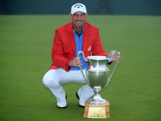 Thomas Bjorn poses with the Omega European Masters trophy after beating Craig Lee in a playoff to win the tournament for a second time on September 8, 2013