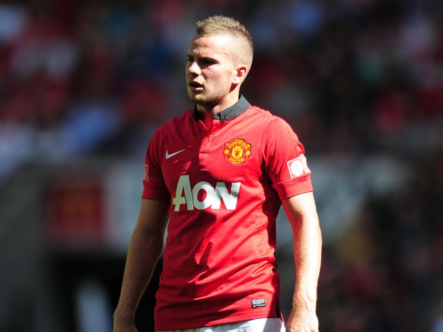 Tom Cleverley of Manchester United looks on during the FA Community Shield match between Manchester United and Wigan Athletic at Wembley Stadium on August 11, 2013
