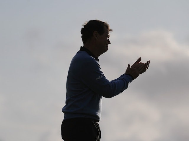 Tom Watson graciously applauds Stewart Cink after losing to him in a playoff at the Open at Turnberry on July 19, 2009