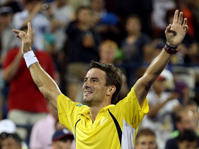 Tommy Robredo of Spain reacts after defeating Roger Federer of Switzerland in their fourth round men's singles match on Day Eight of the 2013 US Open at USTA Billie Jean King National Tennis Center on September 2, 2013