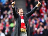 Arsenal legend Tony Adams is seen on the pitch before the Barclays Premier League match between Arsenal and Queens Park Rangers at the Emirates Stadium on December 31, 2011