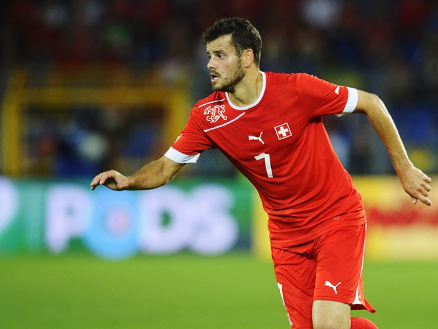 Tranquillo Barnetta of Switzerland controles the ball during the international friendly match between Switzerland and Brazil at St. Jakob Stadium on August 14, 2013