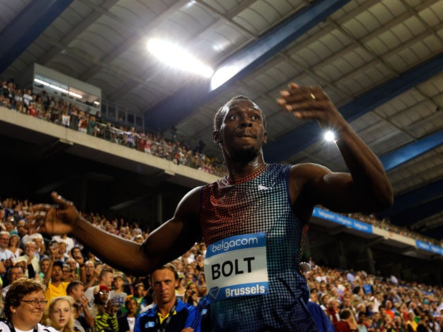 Usain Bolt of Jamaica celebrates winning the 100m final during the 2013 Belgacom Memorial Van Damme IAAF Diamond League meet at The King Baudouin Stadium on September 6, 2013