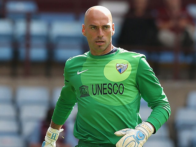 Malaga's Willy Caballero in action during a friendly match against Aston Villa on August 10, 2013