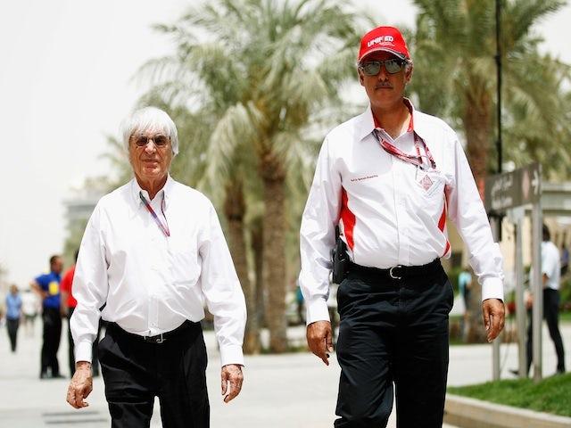 Bahrain International Circuit chief Zayed Al Zayani talks to Bernie Ecclestone on April 20, 2012