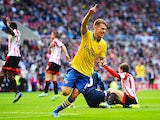 Arsenal's Aaron Ramsey celebrates after scoring his team's third goal against Sunderland on September 14, 2013