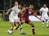 AC Milan's Kaka fends off a Torino player on September 14, 2013
