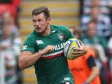 Adam Thompstone of Leicester runs with the ball during the Aviva Premiership match between Leicester Tigers and Worcester Warriors at Welford Road on September 8, 2013