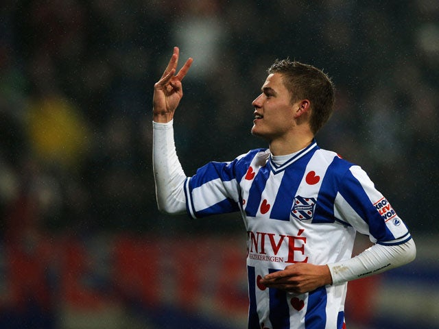 Alfred Finnbogason of Heerenveen celebrates scoring his teams second goal of the game during the Eredivisie match between SC Heerenveen and Vitesse Arnhem at Abe Lenstra Stadion on December 22, 2012
