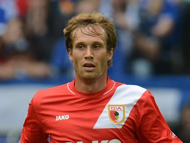 Andreas Ottl keeps possession of the ball against Schalke 04.