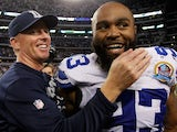 Head coach Jason Garrett of the Dallas Cowboys celebrates with Anthony Spencer #93 of the Dallas Cowboys after the Dallas Cowboys beat the Pittsburgh Steelers 27-24 at Cowboys Stadium on December 16, 2012