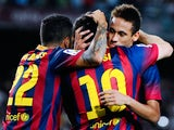 Lionel Messi and Neymar celebrate a goal against Sevilla on September 14, 2013