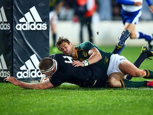 New Zealand's Brodie Retallick scores a try against South Africa during their Rugby Championship match on September 14, 2013