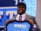 Chance Warmack of the Alabama Crimson Tide holds up a jersey on stage after he was picked #10 overall by the Tennessee Titans in the first round of the 2013 NFL Draft at Radio City Music Hall on April 25, 2013