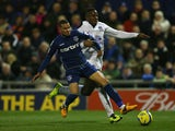 Connor Brown of Oldham Athletic tackles Victor Anichebe of Everton during the FA Cup with Budweiser Fifth Round match between Oldham Athletic and Everton at Boundary Park on February 16, 2013