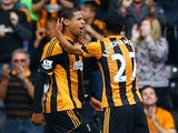 Hull's Curtis Davies is congratulated by team mate Ahmed Elmohamady after scoring the opening goal against Cardiff on September 14, 2013