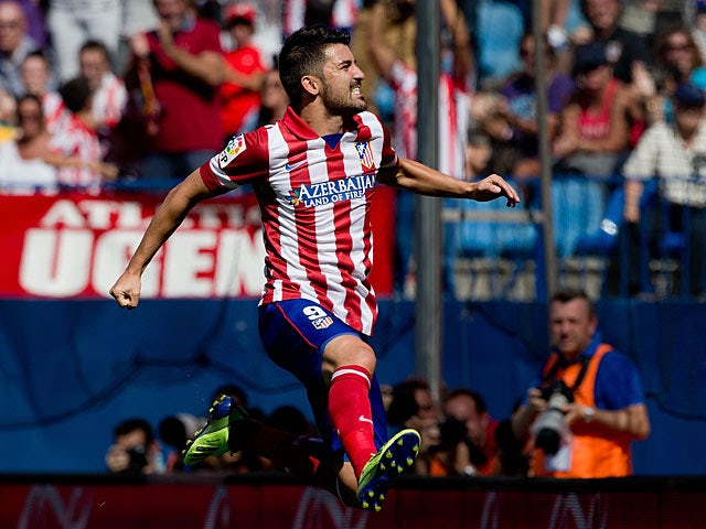 Atletico Madrid's David Villa celebrates after scoring his team's opening goal against Almeria on September 14, 2013