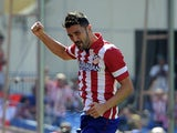 Atletico striker David Villa celebrates a goal against Almeria on September 14, 2013