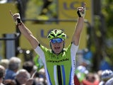 Elia Viviani celebrates as he crosses the finish line at the end of the 191 km second stage of the 65th edition of the Dauphine Criterium cycling race on June 3, 2013