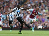 Villa's Fabian Delph and Newcastle's Mapou Yanga-Mbiwa battle for the ball on September 14, 2013