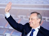 Real Madrid President Florentino Perez waves during a presentation at the Bernabeu on July 13, 2013