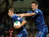 France's Franck Ribery is congratulated by team mate Olivier Giroud after scoring the opening goal against Belarus during their World Cup qualifier on September 10, 2013