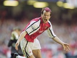 Arsenal's Freddie Ljungberg celebrates scoring the opening goal of the FA Cup final against Liverpool on May 12, 2001