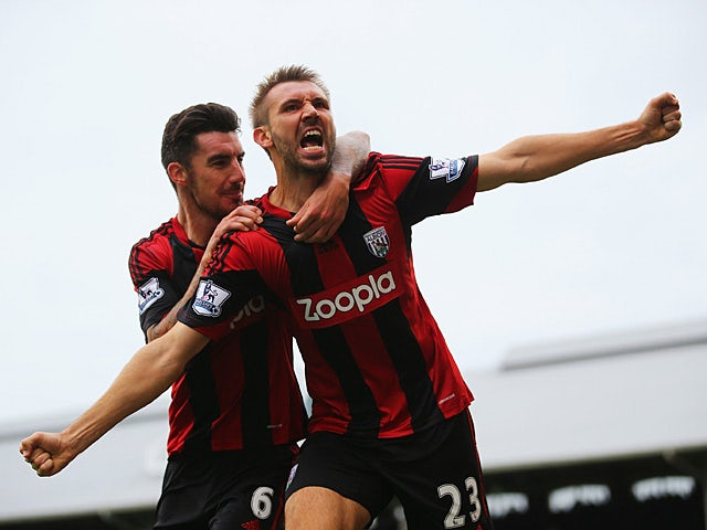 West Brom's Gareth McAuley celebrates with team mate Liam Ridgewell after scoring a late equaliser against Fulham on September 14, 2013
