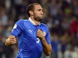 Italy's Giorgio Chiellini celebrates moments after scoring the equaliser against Czech Republic during their World Cup qualifier on September 10, 2013