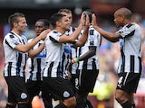 Newcastle players congratulate Hatem Ben Arfa following his goal against Aston Villa on September 14, 2013