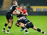 Players of Hull FC and Catalan Dragons fight for possession during their playoff game on September 13, 2013