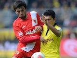 Augsburg midfielder Jan Moravek battles for possession with Nuri Sahin in April 2013.