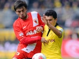 Augsburg midfielder Jan Moravek battles for possession with Nuri Sahin in April 2013.