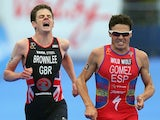 Spain's Javier Gomez crosses the line ahead of Jonathan Brownlee at the PruHealth World Triathlon Grand Final on September 15, 2013