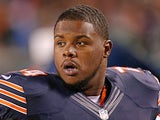 Chicago Bears' Jermon Bushrod watches the game from the bench against Cleveland Browns on August 29, 2013