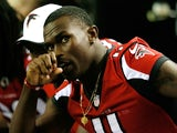 Falcons WR Julio Jones sits on the sidelines on August 14, 2013