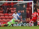 West Ham's Jussi Jaaskelainen saves Southampton's Dani Osvaldo shot on goal during their Premier League match on September 15, 2013