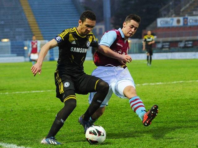 Aston Villa defender Lewis Kinsella attempts to block a cross during the 2013 NextGen Series final.