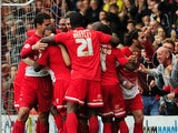 Orient players celebrate a goal by Kevin Lisbie on September 14, 2013
