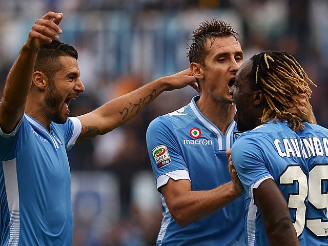 Lazio's Luis Pedro Cavanda is congratulated by team mates Miroslav Klose and Antonio Candreva after scoring his team's second goal in the match against Chievo Verona on September 15, 2013
