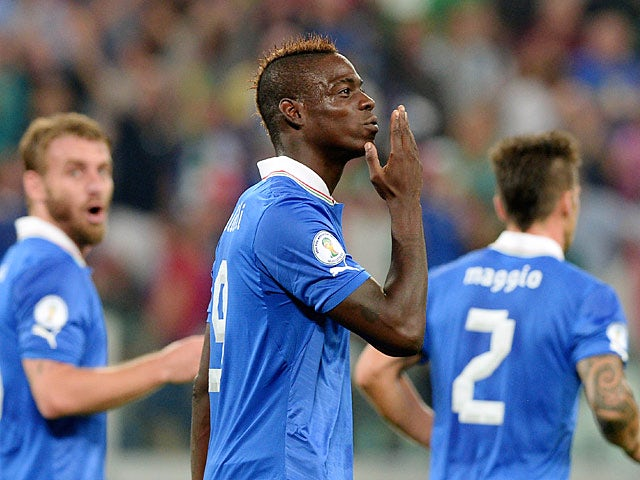 Italy's Mario Balotelli celebrates after scoring his team's second goal against Czech Republic during their World Cup qualifier on September 10, 2013