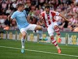 Stoke's Matthew Etherington and Manchester City's James Milner battle for the ball on September 14, 2013