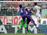 Cagliari's Mauricio Pinilla scores the equaliser during the match against Fiorentina on September 15, 2013