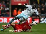 Southampton's Morgan Schneiderlin tackles West Ham's Mo Diame on September 15, 2013