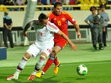 Denmark's Nicki Nielson and Armenia's Hrayr Mkoyan battle for the ball during their World Cup qualifying match on September 10, 2013