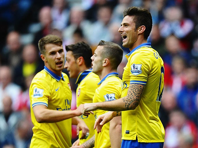 Arsenal's Olivier Giroud celebrates with team mates after scoring the opening goal against Sunderland on September 14, 2013