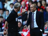 Referee Martin Atkinson has words with Sunderland manager Paolo Di Canio on the touchline during the match against Arsenal on September 14, 2013