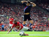 Manchester United's Patrice Evra and Crystal Palace's Mile Jedinak battle for the ball during their Premier League match on September 14, 2013